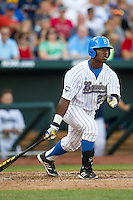 UCLA outfielder Brenton Allen (23) follows through on his swing during Game 12 of the 2013 Men's College World Series against the North Carolina Tar Heels on June 21, 2013 at TD Ameritrade Park in Omaha, Nebraska. The Bruins defeated the Tar Heels 4-1, to reach the CWS Final and eliminate North Carolina from the tournament. (Andrew Woolley/Four Seam Images)