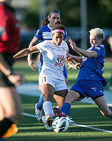 In a National Women's Soccer League Elite (NWSL) match, the Boston Breakers defeated the FC Kansas City, 1-0, at Dilboy Stadium on August 10, 2013.  Boston Breakers midfielder Joanna Lohman (11) slide tackles FC Kansas City midfielder Desiree Scott (11).