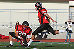 Palos Verdes, CA 11/10/10 - Matt Lopes(Palos Verdes # 29) and unknown Palos Verdes player(s) in action during the junior varsity football game between Peninsula and Palos Verdes at Palos Verdes High School.