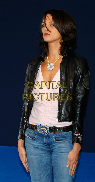 "ASIA ARGENTO.Photocall for ""XXX"" at the Deauville Film Festival, France. .September 7th, 2002.half length black leather jacket .CAP/PL.©Phil Loftus/Capital Pictures."
