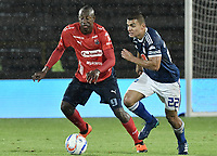 BOGOTA - COLOMBIA, 04-08-2018: Jhon Duque Arias (Der) jugador de Millonarios disputa el balón con Juan F Caicedo (Der) jugador de Deportivo Independiente Medellín durante partido por la fecha 3 de la Liga Águila II 2018 jugado en el estadio Nemesio Camacho El Campin de la ciudad de Bogotá. / Jhon Duque Arias (R) player of Millonarios fights for the ball with Juan F Caicedo (L) player of Deportivo Independiente Medellin during the match for the date 3 of the Liga Aguila II 2018 played at the Nemesio Camacho El Campin Stadium in Bogota city. Photo: VizzorImage / Gabriel Aponte / Staff.