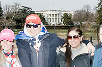 From left, Lola Lopez, 45, Eric Villacis, 41, and Laura Cathy Williams, 37, all of Atlanta, Georgia, pose for pictures outside the White House in Washington, D.C., on Jan. 19, 2017, the day before the inauguration of president-elect Donald Trump. Lopez and Villacis both wore Make America Great Again hats in support of Trump.