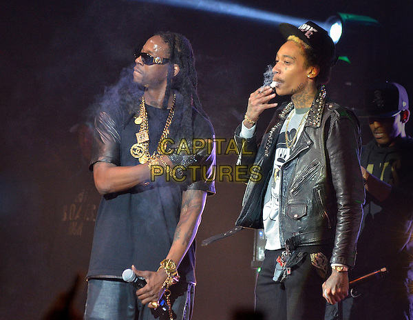 "Rapper 2 CHAINZ (Tauheed Epps) is joined on stage by rapper WIZ KHALIFA on a stop of his ""Based On A T.R.U. Story"" Tour held at the Stage AE, Pittsburgh, PA., USA.   .December 11th, 2012   .on stage in concert live gig performance performing music half length black leather jacket hat sunglasses shades smoking profile .CAP/ADM/JN.©Jason L Nelson/AdMedia/Capital Pictures."
