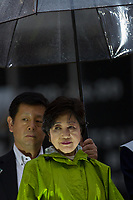 A Special Policeman holds an umbrellas for Yuriko Koike as she is electioneering for her Party of Hope (Kibo no To) at Shibuya crossing, Shibuya, Tokyo, Japan. Friday October 13th 2017 Koike became the Governor of Tokyo after splitting from the ruling Liberal Democratic Party (LDP)  and running against their candidate. She formed her own party after Prime Minister Shinzo Abe called a snap election. Though not running for office herself this election she remains a popular figure and campaigns for her candidates. and is predicted to weaken Abe's majority. in the Diet.