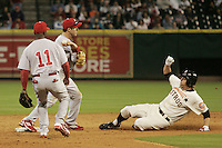 Philadelphia Phillies 2B Chase Utley turns a double play as Jason Michaels slides on Turn Back the Clock Nite. Game played on Saturday April 10th, 2010 at Minute Maid Park in Houston, Texas.  (Photo by Andrew Woolley / Four Seam Images)