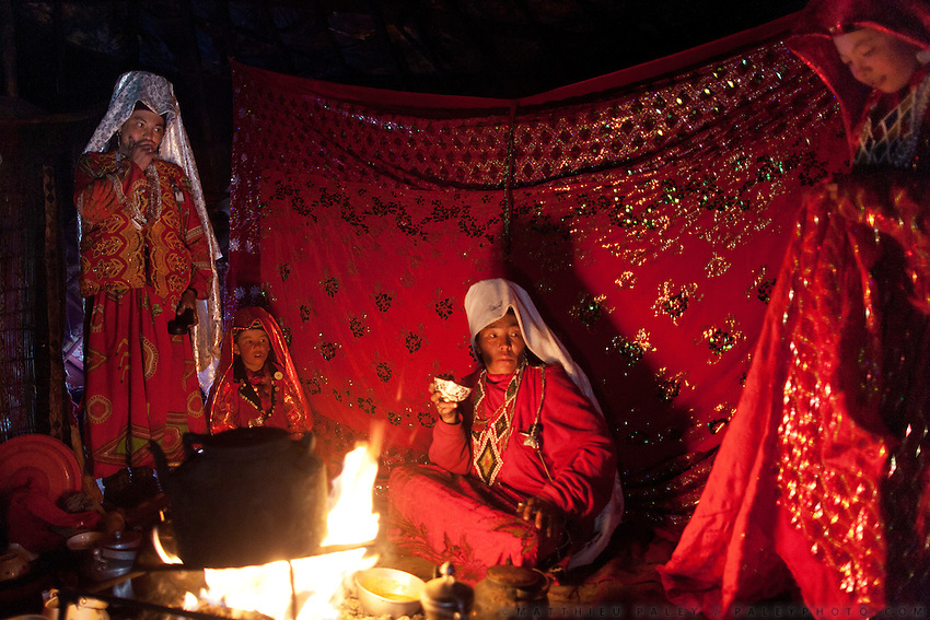 At night, elder women watch the girl who is about to get married, at the Kitshiq Aq Jyrga camp...Trekking through the high altitude plateau of the Little Pamir mountains (average 4200 meters) , where the Afghan Kyrgyz community live all year, on the borders of China, Tajikistan and Pakistan.