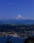 Mount Hood sits behind the city of Hood River along the Columbia river with sailboat marina at sunet Oregon State USA