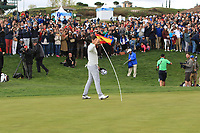 Nacho Elvira (ESP) with the flag on the 18th green during Round 4 of the Open de Espana 2018 at Centro Nacional de Golf on Sunday 15th April 2018.<br /> Picture:  Thos Caffrey / www.golffile.ie<br /> <br /> All photo usage must carry mandatory copyright credit (&copy; Golffile | Thos Caffrey)