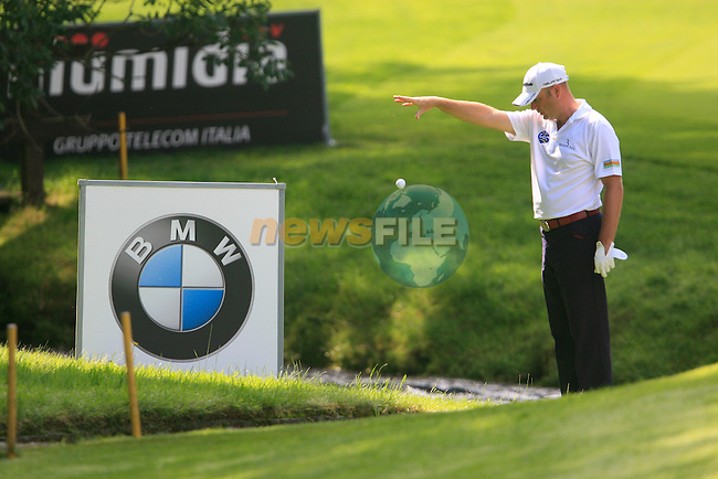 Graeme Storm (ENG) takes a drop after his ball entered the stream at the 5th green during Day 3 of the BMW Italian Open at Royal Park I Roveri, Turin, Italy, 11th June 2011 (Photo Eoin Clarke/Golffile 2011)