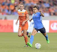 Houston, TX - Friday April 29, 2016: Raquel Rodriguez (11) of Sky Blue FC passes the ball as Cami Privett (23) of the Houston Dash looks on at BBVA Compass Stadium. The Houston Dash tied Sky Blue FC 0-0.