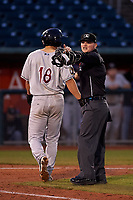 Umpire Lance Seilhamer holds Brent Diaz (18) after an altercation between Diaz and the opposing pitcher during a Midwest League game between the Wisconsin Timber Rattlers and the Lansing Lugnuts at Cooley Law School Stadium on May 1, 2019 in Lansing, Michigan. Wisconsin defeated Lansing 2-1 in the second game of a doubleheader. (Zachary Lucy/Four Seam Images)