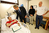 Washington, DC - December 22, 2008 -- United States President George W. Bush shakes the hand of United States Army PFC Lukas Shook of Strafford, Missouri, after presenting him with a Purple Heart Monday, December 22, 2008, during a visit to Walter Reed Army Medical Center, where the soldier is recovering from injuries received in Operation Iraqi Freedom.  Looking on his PFC Shook's mother and father,  Dennis and Cynthia Shook. .Credit: Eric Draper - White House via CNP