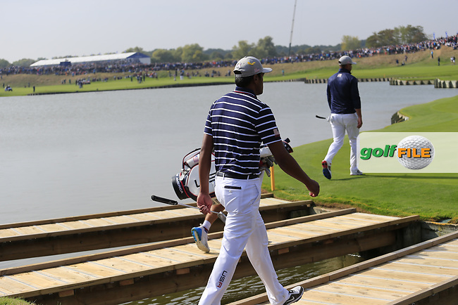 Tony Finau Team USA walks onto the 18th green during Friday's Fourball Matches at the 2018 Ryder Cup, Le Golf National, Iles-de-France, France. 28/09/2018.<br /> Picture Eoin Clarke / Golffile.ie<br /> <br /> All photo usage must carry mandatory copyright credit (© Golffile   Eoin Clarke)