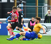 Lincoln City's Shay McCartan vies for possession with  Mansfield Town's Ryan Sweeney<br /> <br /> Photographer Andrew Vaughan/CameraSport<br /> <br /> The EFL Sky Bet League Two - Lincoln City v Mansfield Town - Saturday 24th November 2018 - Sincil Bank - Lincoln<br /> <br /> World Copyright &copy; 2018 CameraSport. All rights reserved. 43 Linden Ave. Countesthorpe. Leicester. England. LE8 5PG - Tel: +44 (0) 116 277 4147 - admin@camerasport.com - www.camerasport.com