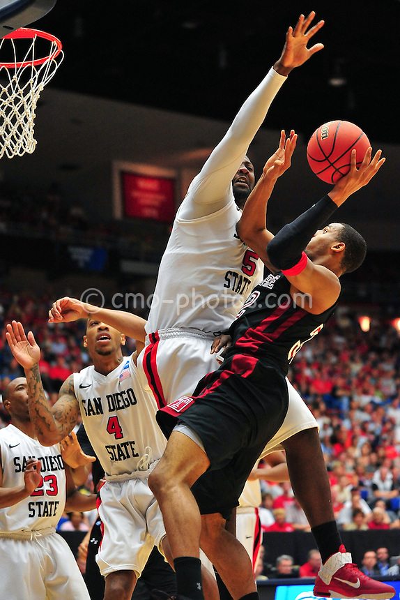 Mar 19, 2011; Tucson, AZ, USA; San Diego State Aztecs center Brian Carlwell (5) blocks the shot of Temple Owls forward Rahlir Jefferson (32) in the first half of a game in the third round of the 2011 NCAA men's basketball tournament at the McKale Center.