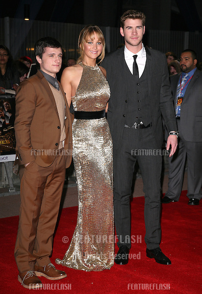 Josh Hutcherson, Jennifer Lawrence and Liam Hemsworth arrive at the European Premiere of 'The Hunger Games' at the O2 Arena, London. 14/03/2012 Picture by: Alexandra Glen / Featureflash