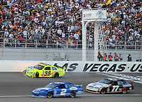 Mar. 1, 2009; Las Vegas, NV, USA; NASCAR Sprint Cup Series driver Paul Menard (98) crashes during the Shelby 427 at Las Vegas Motor Speedway. Mandatory Credit: Mark J. Rebilas-