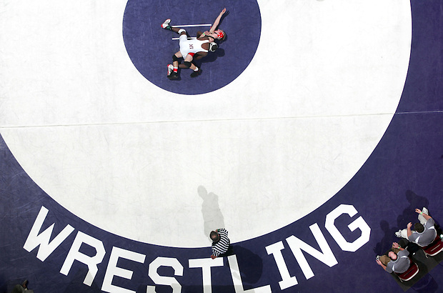 Mount Vernon's Eyasu Russell controls Adel DeSoto Minburn's Keegan Mumma at 125 lbs during the first round of the Class 2A Iowa high school state wrestling tournament at Wells Fargo Arena on February 19, 2009 in Des Moines, Iowa.