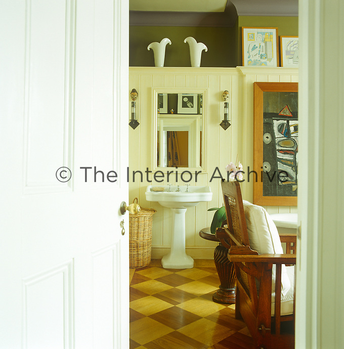 A glimpse through the open door of the bathroom reveals it is furnished with an Arts and Crafts chair