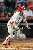 Philadelphia Phillies second baseman Chase Utley #26 heads to first base during the Major League baseball game against the Houston Astros on September 16th, 2012 at Minute Maid Park in Houston, Texas. The Astros defeated the Phillies 7-6. (Andrew Woolley/Four Seam Images).