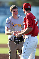 Galen Snyder shakes hands with Adam Bileckyj #13 after throwing out the ceremonial first pitch before a game between the Batavia Muckdogs and Jamestown Jammers at Dwyer Stadium on June 28, 2011 in Batavia, New York.  Jamestown defeated Batavia 5-1.  (Mike Janes/Four Seam Images)