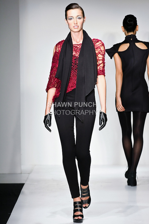 Model walks the runway in a Raw Sophistication outfit, designed by Suzie Ford, during the Pratt Institute 2010 Fashion Show on May 13, 2010.