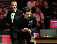 Ronnie O'Sullivan eyes up his next shot during the Dafabet Masters FINAL between Barry Hawkins and Ronnie O'Sullivan at Alexandra Palace, London, England on 17 January 2016. Photo by Liam Smith / PRiME Media Images