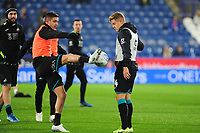 Kristoffer Peterson and Jake Bidwell of Swansea City during the pre-match warm-up for the Sky Bet Championship match between Huddersfield Town and Swansea City at The John Smith's Stadium in Huddersfield, England, UK. Tuesday 26 November 2019