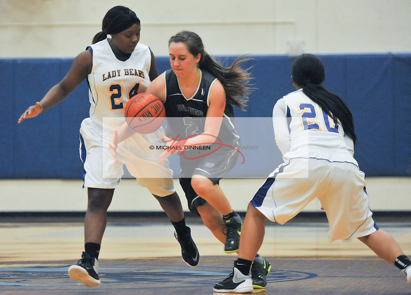 Eagle River's Tessa Hagy drives through the defense of Bartlett's Montasia Brown (24) and Tala Lauvale (20) at Bartlett High School Tuesday, January 6, 2016.  Photo for the Star by Michael Dinneen