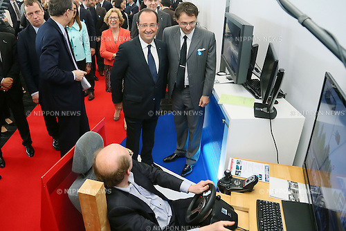 "June 7, 2013, Tokyo, Japan - France's President Francois Hollande observes a product using a new technology of information and communication during ""Innovons ensemble"", at Shibuya Hikarie in Tokyo, Japan, June 7, 2013.  President Hollande is in Japan for a three-day state visit. (Photo by Yusuke Nakanishi/Pool/Abaca Presse)"