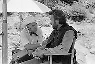 Mexico, 1969. Film director Don Siegel and actor Clint Eastwood on the movie set of the American 1970 western film Two Mules for Sister Sara. Eastwood starred as the cowboy Hogan, Shirley Maclaine starred as Sister Sara in the comedy, and Siegel directed.