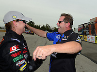 Sept. 30, 2012; Madison, IL, USA: NHRA runner-up driver Allen Johnson (right) congratulates pro stock driver Erica Enders after winning the Midwest Nationals at Gateway Motorsports Park. Mandatory Credit: Mark J. Rebilas-