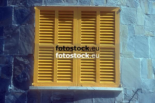yellow wooden slatted window shutter<br /> <br /> persiana amarilla<br /> <br /> gelber Holzfensterladen<br /> <br /> Original: 35 mm slide transparency