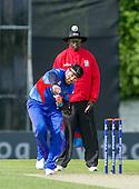 ICC World T20 Qualifier - GROUP B MATCH - NETHERLANDS V AFGHANISTAN at Grange CC, Edinburgh - Afghanistan bowler Hamid Hassan bowls past Umpire David Odhiambo — credit @ICC/Donald MacLeod - 09.07.15 - 07702 319 738 -clanmacleod@btinternet.com - www.donald-macleod.com