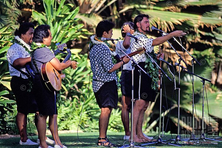 Ho'okena, a popular Hawaiian music group, performs in an outdoor concert.