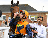 Marshal Dan gets a kiss on the nose from jockey Stefano  Cherchi after winning The Shadwell Racing Excellence Apprentice Handicap during Afternoon Racing at Salisbury Racecourse on 16th May 2019