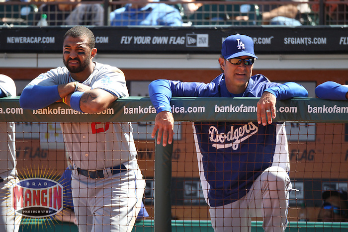 SAN FRANCISCO, CA - JULY 28:  Matt Kemp #27 and manager Don Mattingly #8 of the Los Angeles Dodgers watch in the dugout during the game against the San Francisco Giants at AT&T Park on Saturday, July 28, 2012 in San Francisco, California. Photo by Brad Mangin