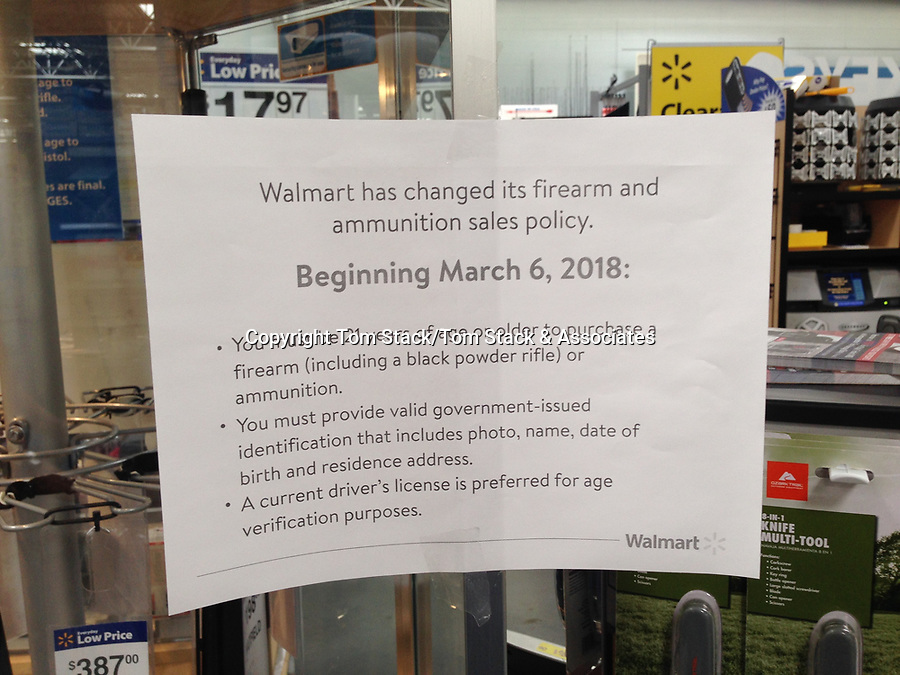 Lecanto, Florida - March 6, 2018: A Walmart Supercenter posts a sign announcing their new firearm and ammunition sales policy.  In order to purchase a firearm or ammunition you must now be 21 years of age or older.