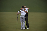 AUGUSTA, GA - APRIL 14: Adam Scott of Australia hugs Angel Cabrera of Argentina after sinking a birdie putt on the 74th hole of their playoff during the Final Round of the 2013 Masters Golf Tournament at Augusta National Golf Club on April 14, 2013 in Augusta, Georgia. Adam Scott became the first Australian ever to win the famed Masters Golf Tournament , one of the four major championships, in it's 79 year history.