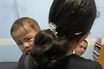 Dr. Bhurtel Prajwol talks with Mirakel Guarin as she hold her 10-month old con Johan in the emergency room of the Mary Johnston Hospital in Manila, Philippines. The boy was suffering from diarrhea.<br /> <br /> The hospital is supported by United Methodist Women.