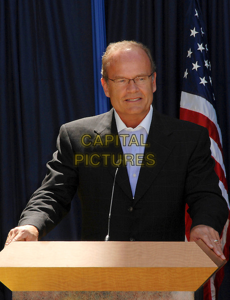 KELSEY GRAMMER .Stamps of Simpsons Characters are Unveiled held at The Fox Studios, Los Angeles, California, USA..May 7th, 2009.half length podium black suit jacket glasses .CAP/ADM/KB.©Kevan Brooks/AdMedia/Capital Pictures.