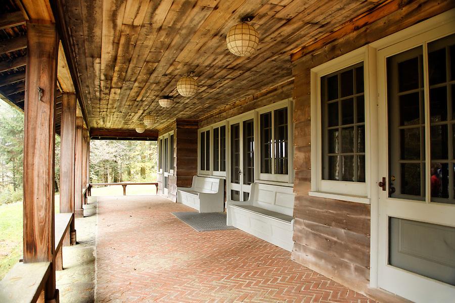 Porch of Adirondack-style summer house, Marsh-Billings-Rockefeller National Historic Park, Woodstock, Vermont, USA