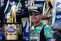 Sept. 14, 2012; Concord, NC, USA: NHRA pro stock motorcycle rider Andrew Hines poses next to the championship trophy during qualifying for the O'Reilly Auto Parts Nationals at zMax Dragway. Mandatory Credit: Mark J. Rebilas-