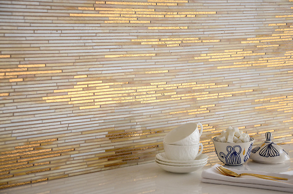 Reve, a handmade mosaic shown in 24K Gold Glass and Agate and Quartz Jewel Glass, is part of the Aurora® collection by Sara Baldwin for New Ravenna.