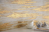 Reve, a handmade mosaic shown in 24K Gold Glass and Agate and Quartz Jewel Glass, is part of the Aurora™ Collection by Sara Baldwin for New Ravenna.