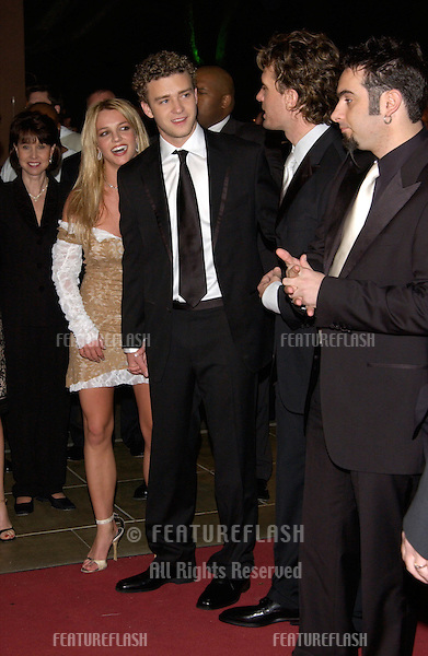 Pop star BRITNEY SPEARS with boyfriend *NSYNC star JUSTIN TIMBERLAKE & the other members of *NSync at pre-Grammy party given by Clive Davis of J Records at the Beverly Hills Hotel..25FEB2002  © Paul Smith / Featureflash