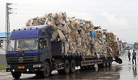 Rubbish from around the world including the United Kingdom is recycled in Mai village, Shunde, China.  There is so much re-cycling in the area that the waste plastic spills out into streams and farmland polluting the environment.<br /> <br /> Photo by Richard Jones/ Sinopix