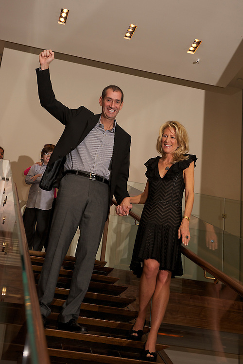 The parents making their grand entrance down a staircase at Rouge Tomate in NYC.