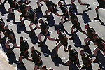 "Marines take part in early morning excercise referred to as ""PT"" for physical training - one of a dizzying array of acronyms used by the Corps. Aboard ship, Marines are required to take part in PT six days a week, often while carrying their weapons and fully dressed in boots and body armor, to prepare themselves for the rigors of the upcoming deployment in the heat and dust of Iraq."