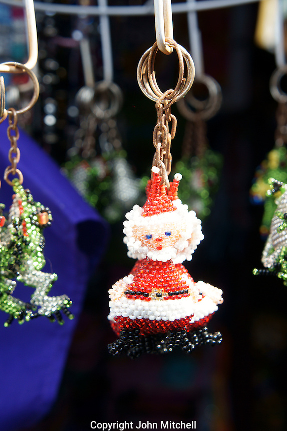 Santa Claus Christmas ornament key chain in Mercado 28 souvenirs and handicrafts market in  Cancun, Mexico      .